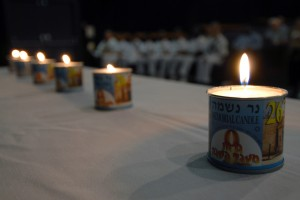 070426-N-4965F-003 PEARL HARBOR, Hawaii (April 26, 2007) - Six memorial candles are lit during a Holocaust Remembrance Day ceremony at Sharkey Theater on board Naval Station Pearl Harbor. The six candles were lit during the opening remarks of the remembrance observation to commemorate the lives of more than 6 million Jews that were lost during the Holocaust. U.S. Navy photo by Mass Communication Specialist 1st Class James E. Foehl (RELEASED)